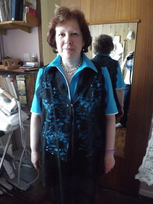 Boo modelling lace waistcoats